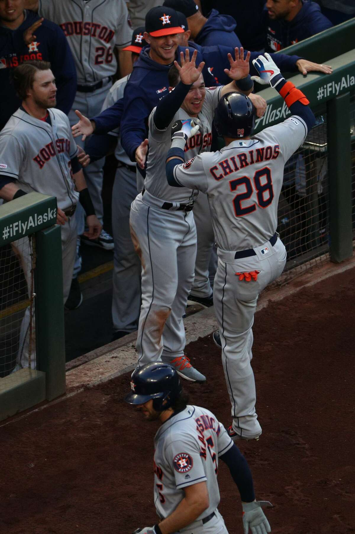 SEATTLE, WASHINGTON - JUNE 03: Robinson Chirinos #28 of the Houston Astros celebrates with teammates after hitting a solo home run against the Seattle Mariners in the first inning during their game at T-Mobile Park on June 03, 2019 in Seattle, Washington. (Photo by Abbie Parr/Getty Images)