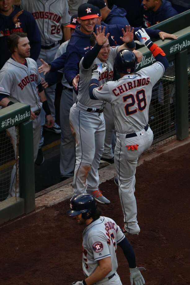 SEATTLE, WASHINGTON - JUNE 03: Robinson Chirinos #28 of the Houston Astros celebrates with teammates after hitting a solo home run against the Seattle Mariners in the first inning  during their game at T-Mobile Park on June 03, 2019 in Seattle, Washington. (Photo by Abbie Parr/Getty Images) Photo: Abbie Parr/Getty Images