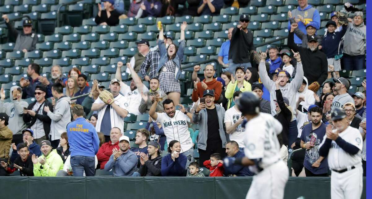 Seattle Mariners fans cheer as Edwin Encarnacion rounds the bases after hitting a solo home run against the Houston Astros during the third inning of a baseball game, Monday, June 3, 2019, in Seattle. (AP Photo/Ted S. Warren)