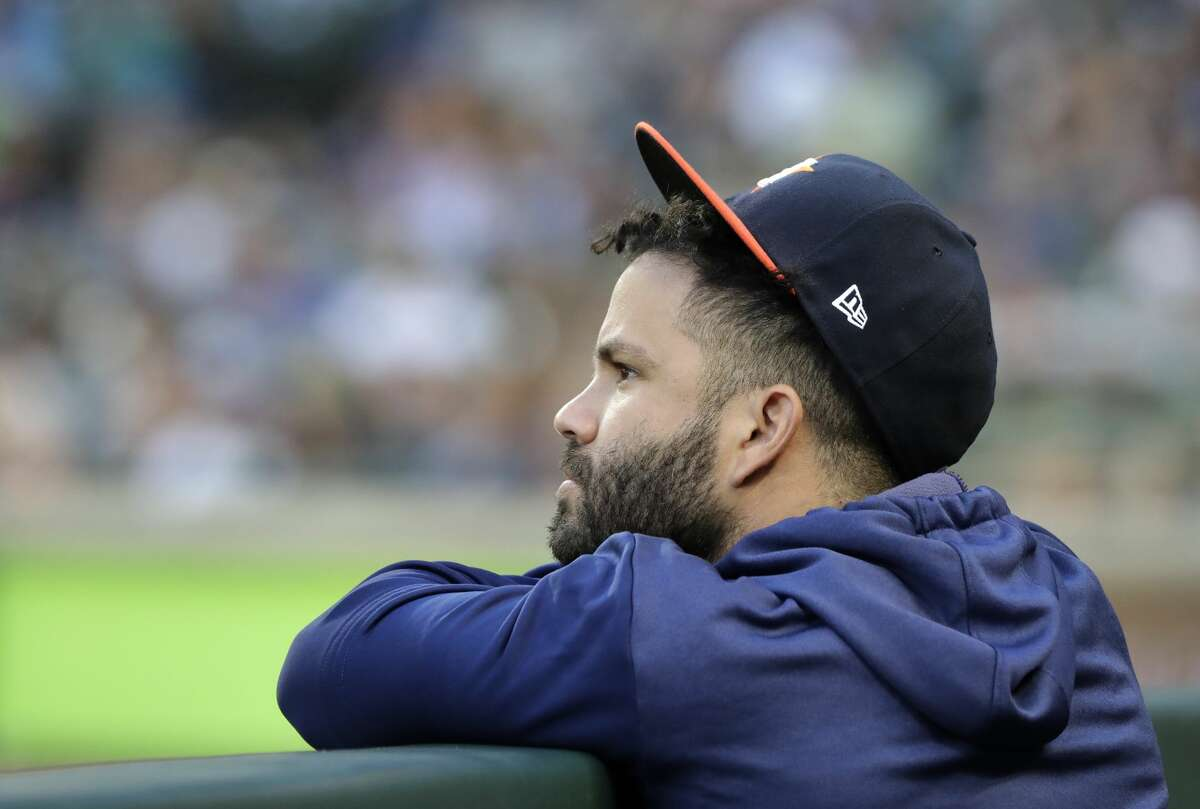 Injured Houston Astros second baseman Jose Altuve watches from the dugout during the third inning of a baseball game against the Seattle Mariners, Monday, June 3, 2019, in Seattle. (AP Photo/Ted S. Warren)