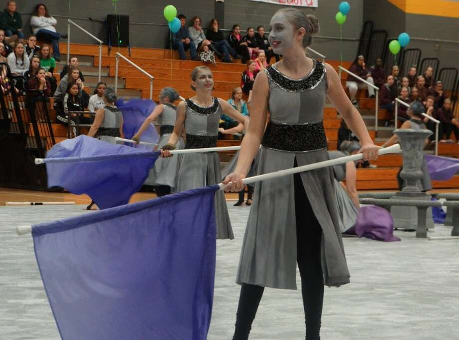 A Color Guard member performs at last year's MAC Championships.