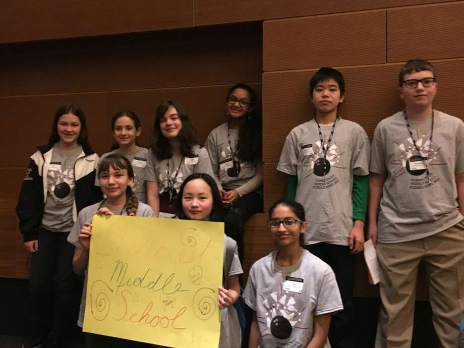 Hillcrest Middle School students Michael Rolleri, Daniel Cao, Erin Forger, Sarah Gold, Jessica Nyitrai, Sadie Walker, Grace Xiong, Sia Kulkarni, and Neya Kidambi participate in the school's first academic Science Bowl at the University of Connecticut.