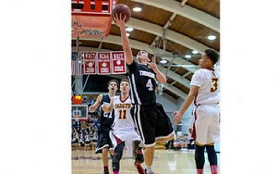 Trumbull's Jack Moore gets inside to score two of his 22 points. — David G. Whitham photo