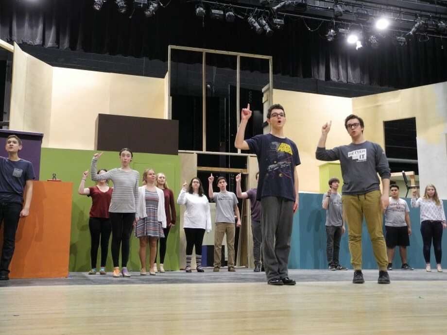 The cast of How to Succeed in Business Without Really Trying goes through a rehearsal at the Trumbull High School auditorium.