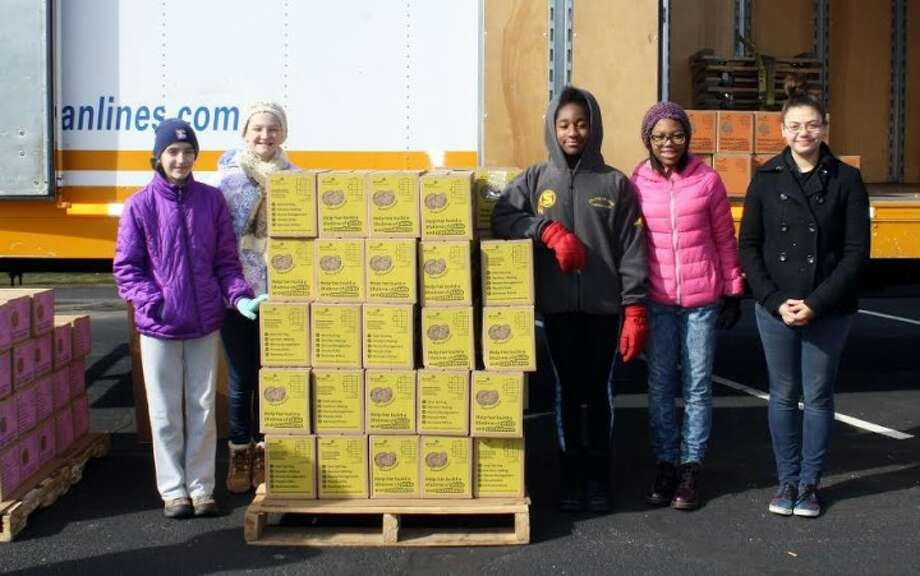 Trumbull Girl Scouts Caitlin, Catherine, Akilah, Megan, and Cassondra from Trumbull help out at the Trumbull Cookie Delivery site. Nearly two million boxes of Girl Scout Cookies arrived in Connecticut on Saturday, Feb. 27.