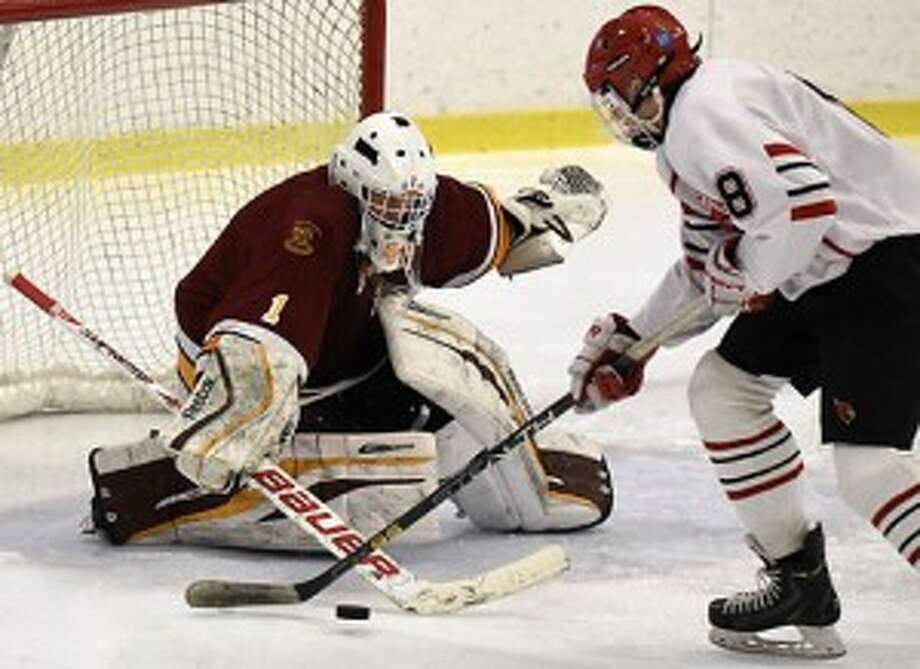 St. Joseph's Ryan Wilson looks to stop Greenwich's Alex Mozian during the FCIAC title game. — Dave Stewart photo