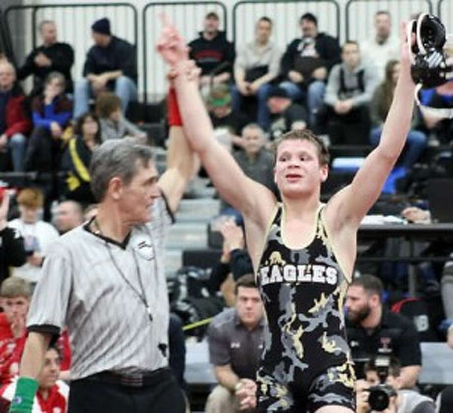 Trumbull's Tristan Haviland has his hands raised after winning the program's first New Enfland title. — Michele Mirmina photo