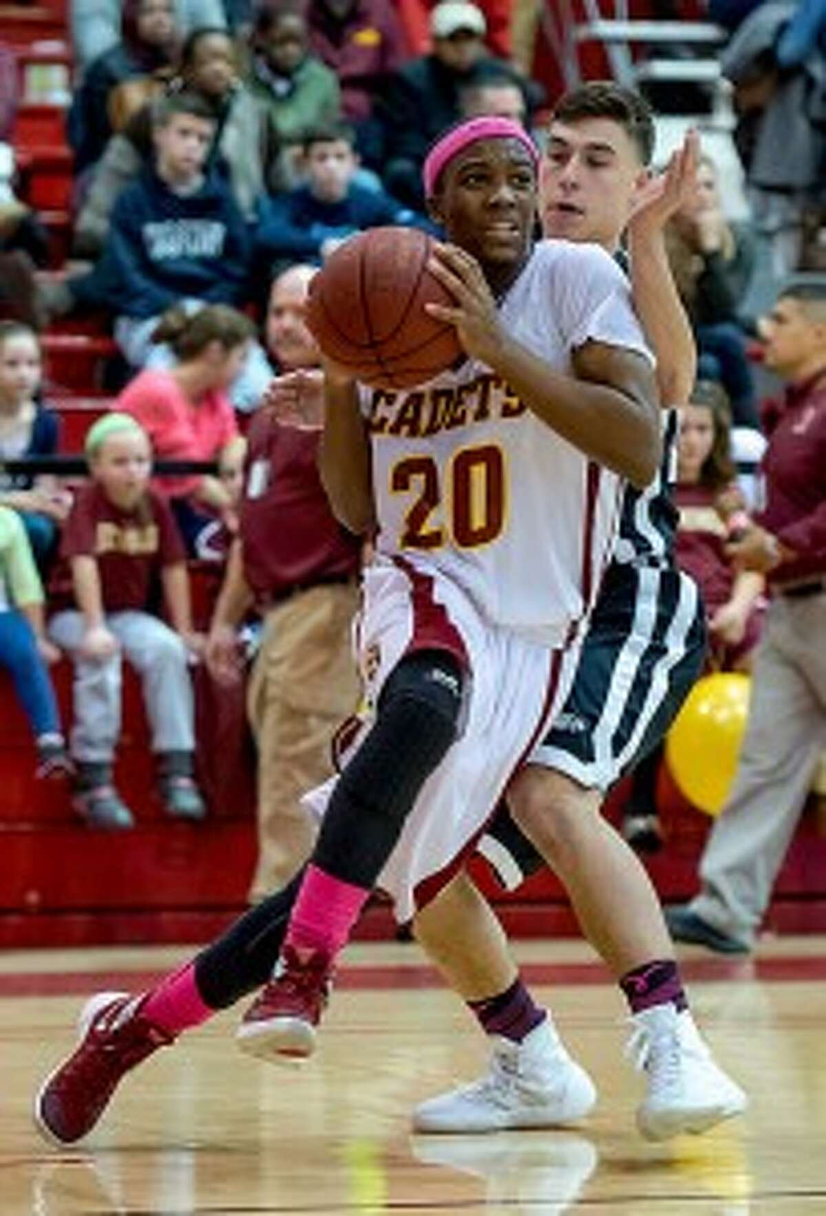 Omar Telfer, driving to the hoop versus Trumbull, scored 12 points in the Cadets' 63-58 win over Bridgeport Central. - David G. Whitham photo