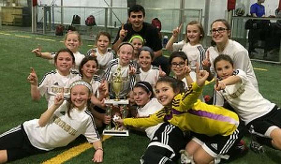 The Trumbull United U9 girls soccer team won the Tri-Town tourney title. Team members are coaches Tyler Jorge and Kyri Marinos; players Peyton Bashar, Sophia Bennett, Grace Cespo, Remy DeNomme, Olivia Flores, Abby Gruttadauria, Jane Hall, Katie Marchand, Emily Meagher, Catalina Mozzo, Katherine Pollock, Lily Seltenrich and Jocelyn VanStone. Missing from photo are Riley Connolly, Danika Curtin, Olivia DeLawder, Abby Lee and Christina Nogueira.