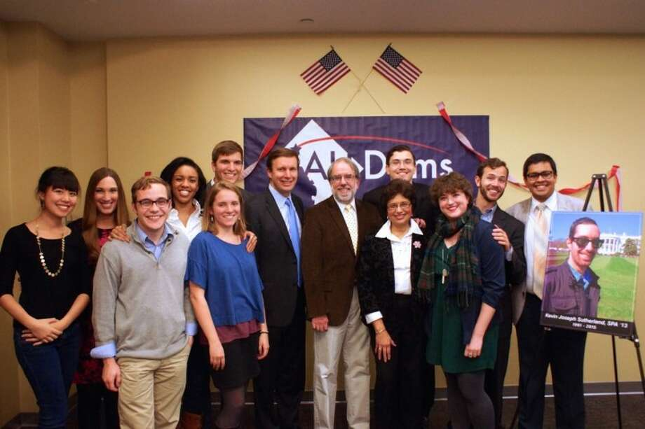​Friends who served in the American University College Democrats Club with Trumbull native Kevin Sutherland — Kathryn Tinker, Sarah McBride, Joe Ste. Marie, Tya Scott, Liz Richards, Philip Scranage, Sam Hagedorn, Abigail Seaver, Bo Hammand, and Palak Gosar — stand with U.S. Sen. Chris Murphy and Kevin's parents, Doug and Theresa Sutherland, at a banquet held on the campus in Washington, D.C., on Dec. 1.