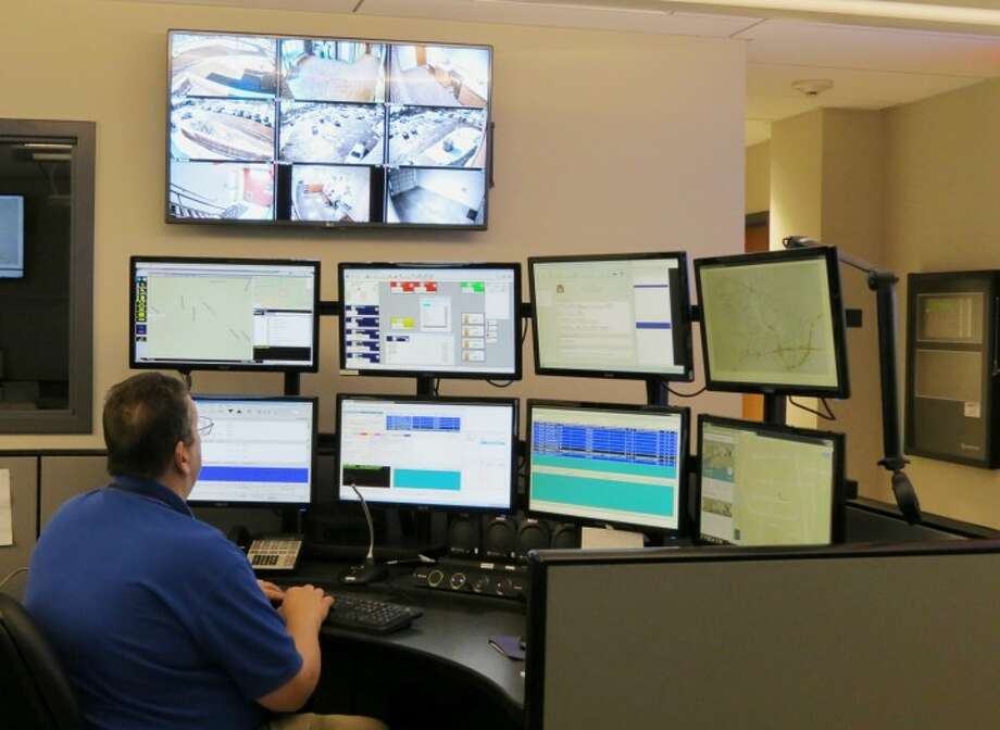 Trumbull Police Dispatcher John Butz works at the new Emergency Communications Center console at police headquarters.