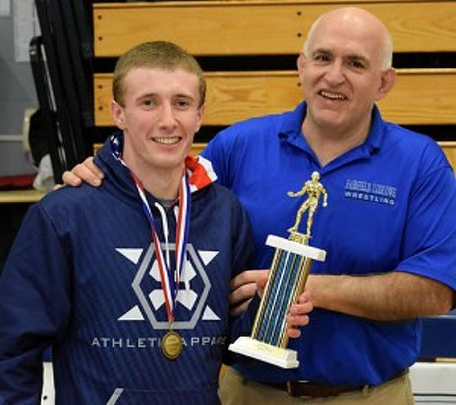 Brian Keyes is congratulated by Fairfield Ludlowe head varsity wrestling coach Nick Garofalo after earning MVP honors. — Dee Sollenberger photo