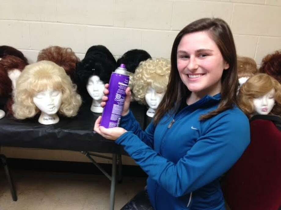 St. Joseph High School senior Cecilia Debroff poses with a can of hairspray before a performance in Center Stage Theatre's Teen Musicial Theatre Workshop.