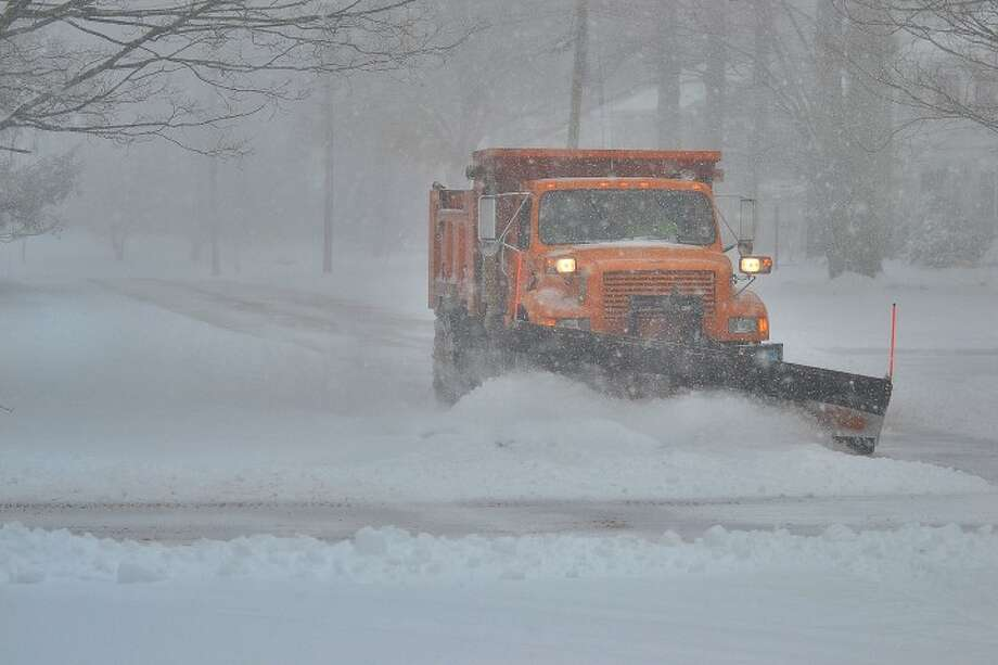 The plows are out on the roads, cleaning up Friday morning's snowstorm. — Lisa Romanchick photo