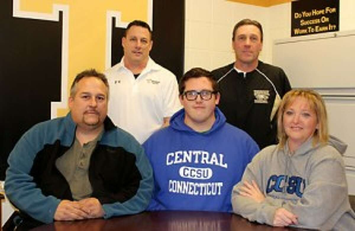 Justin Appleby, a two-way lineman at Trumbull High, has signed his letter of intent to play football at Central Connecticut State University. Appleby, flanked by his mom Darcy and dad Russell, was joined by Trumbull line coach Bill Pinto and head coach Bob Maffei. - John Kovach photo