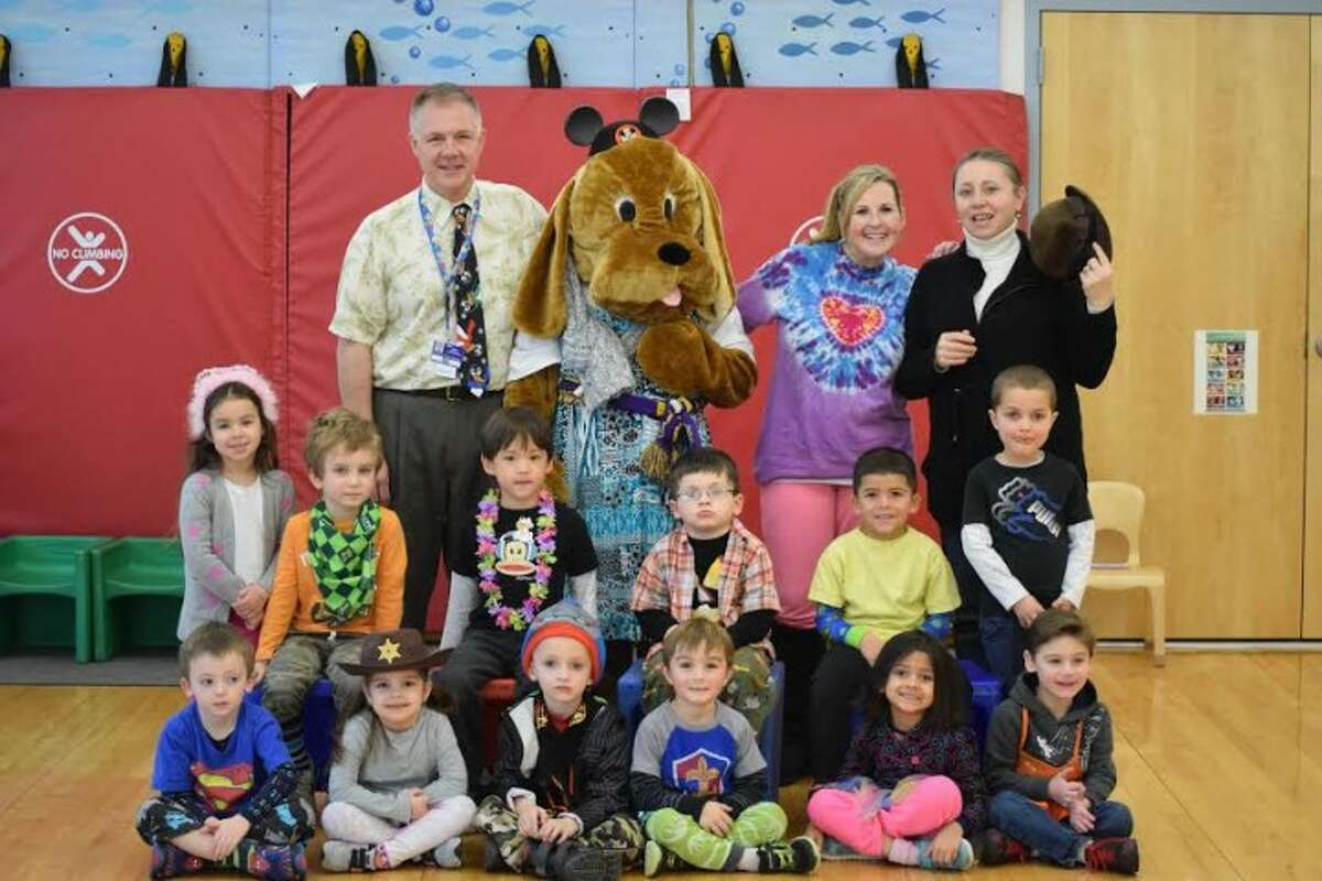 Mrs. Miller's class celebrated Wacky Tacky Day with Barky and preschool director, Dr. Wheeler. Students at Trumbull Early Childhood Education Center filled the school bucket with pom poms, earned for positive behaviors with teachers and friends. An assembly and dress up day recognized their achievements.