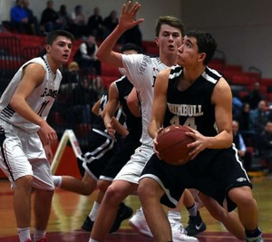 Trumbull's Alexander Recker looks for a shot as New Canaan's Jackson Selvala defends Tuesday night at NCHS. — Dave Stewart photo