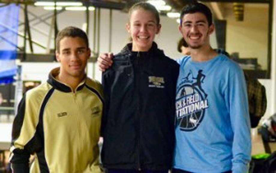 Tyler Gleen, Kate Romanchick and Tyler Rubush at the Alfa Owl Invite. Gleen and Rubush broke the THS record for boys 1000 meter run and Romanchick broke the Alfa Owl Meet record for the girls 1600.