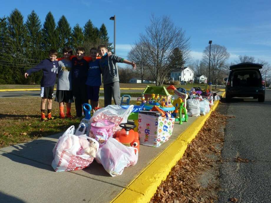 Local students collect toys outside of Tashua Elementary School part of a Second Chance Toys drive held in December.