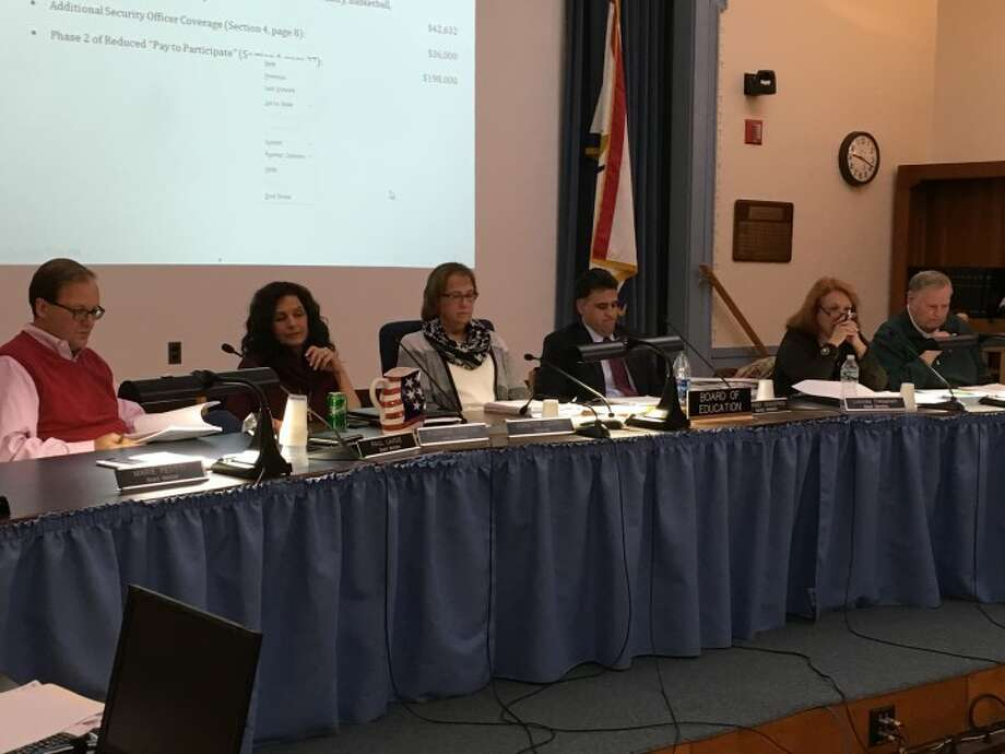 Trumbull's Board of Education reviews the superintendent's proposed budget at Tuesday night's meeting.