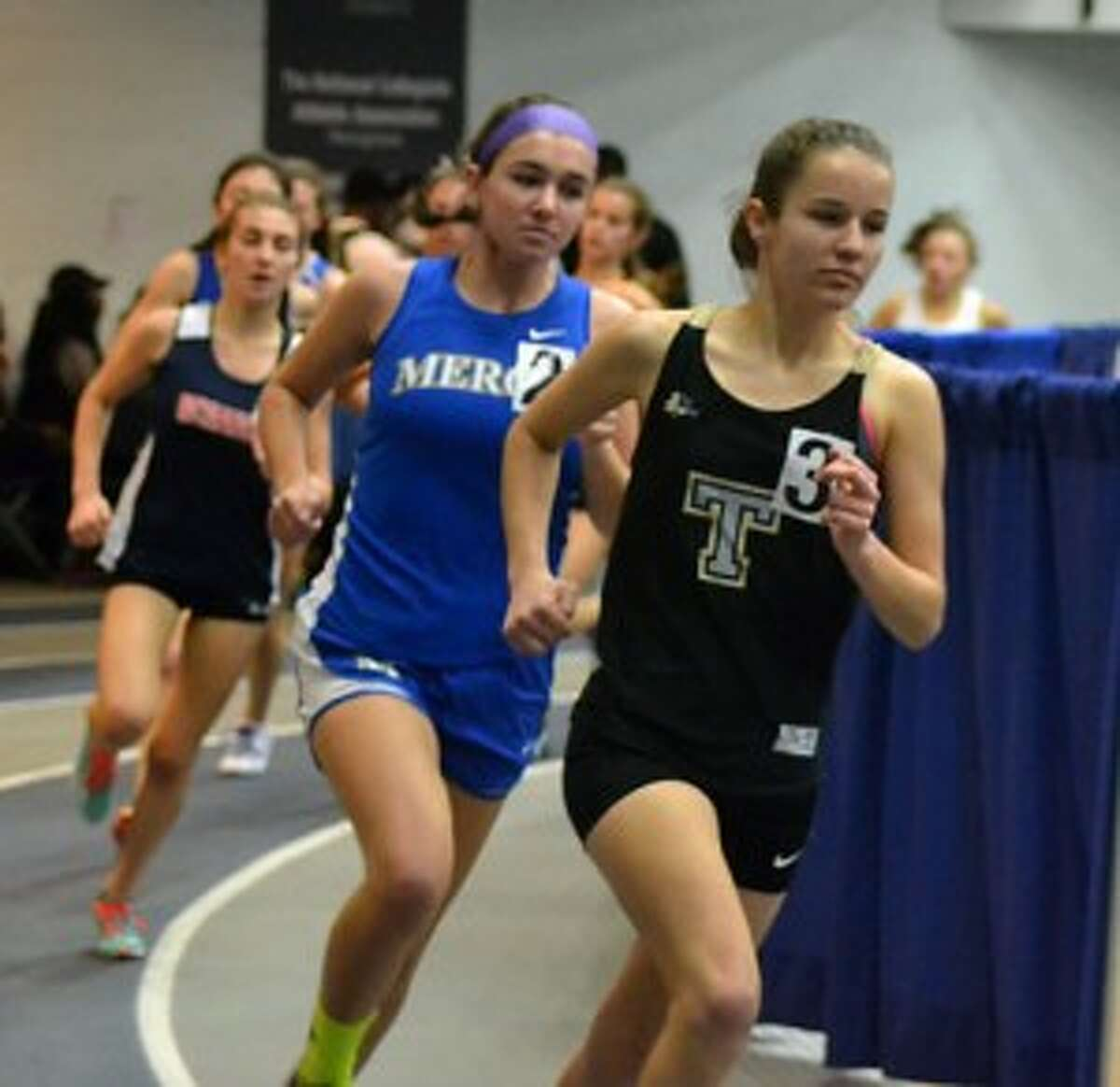 Kate Romanchick leads the way in the 3000 meter run at the Wintergreen Invitational.