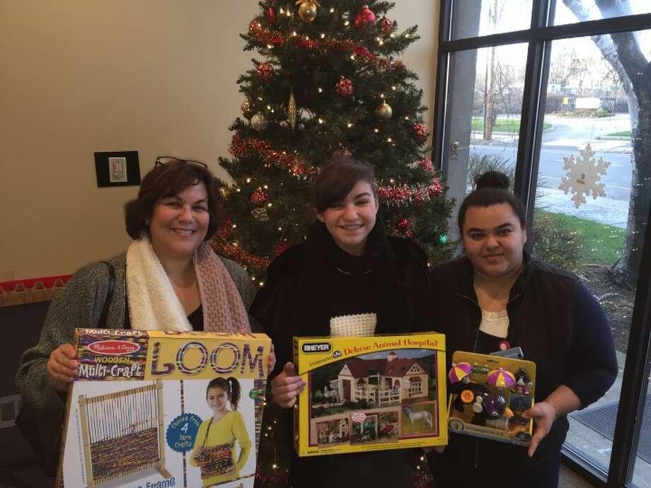Cindy Anelante, Cassandra Anelante and Rosario Terron, lead bilingual advocate at The Center for Family Justice. — John Brannelly photo