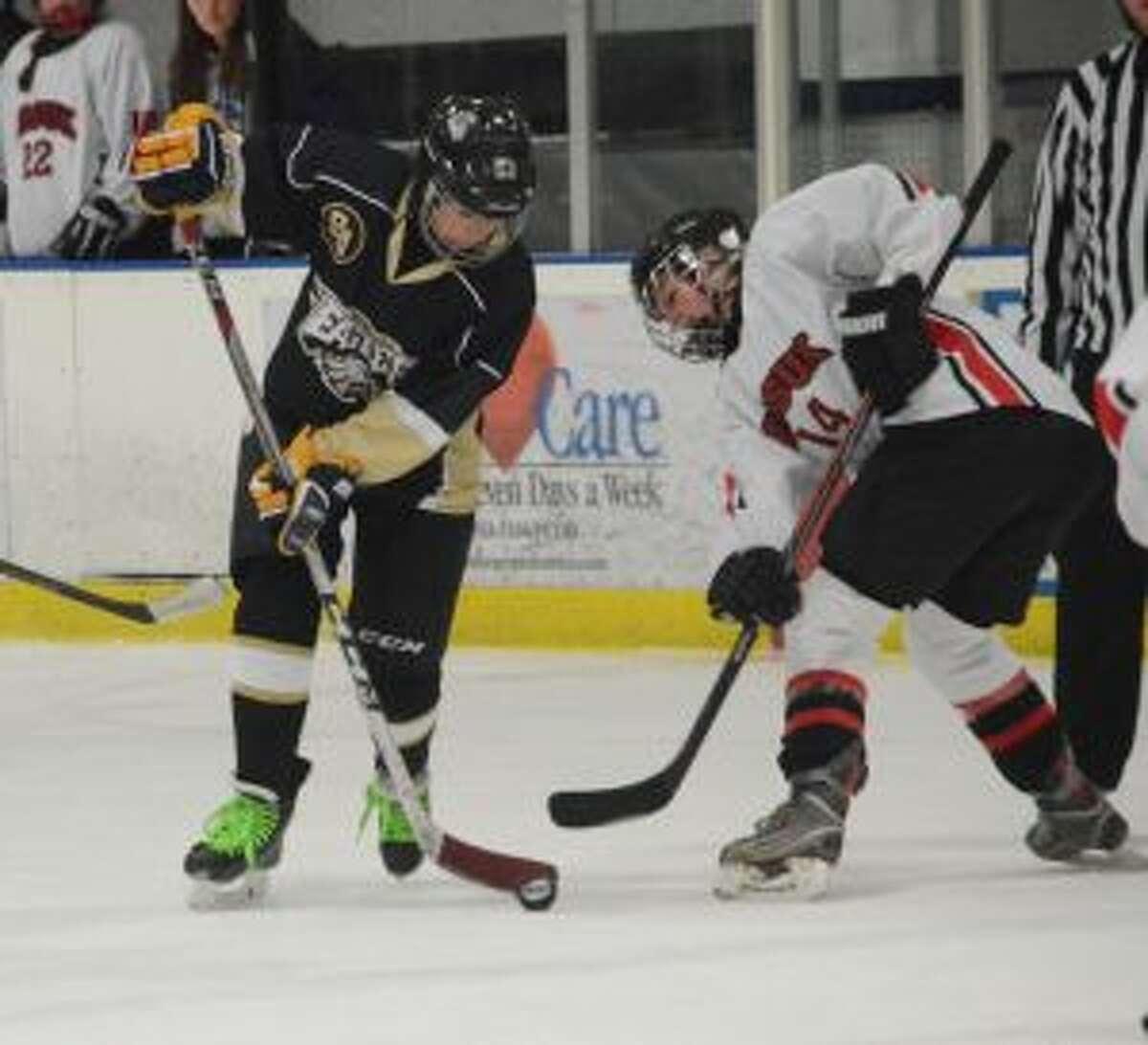 Trumbull-St. Joseph's Marcie Silberger wins a face-off. - Andy Hutchison photo