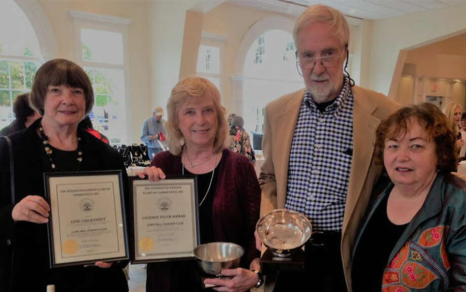 Displaying the awards given to the Long Hill Garden Club are Marilyn Burkhart, Kathy Feller, Walter Callagy and Cheryl Damiani.