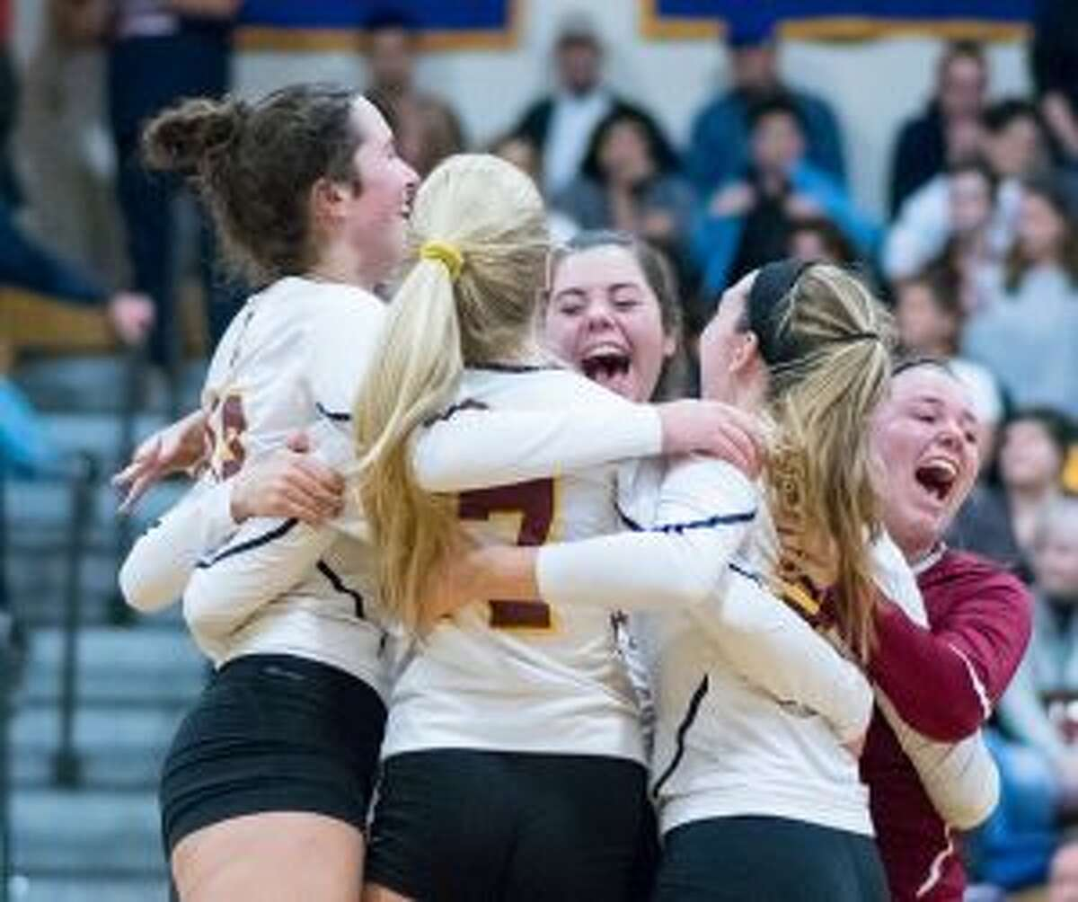 The Cadets get together after winning the Class M state championship. - David G. Whitham photos
