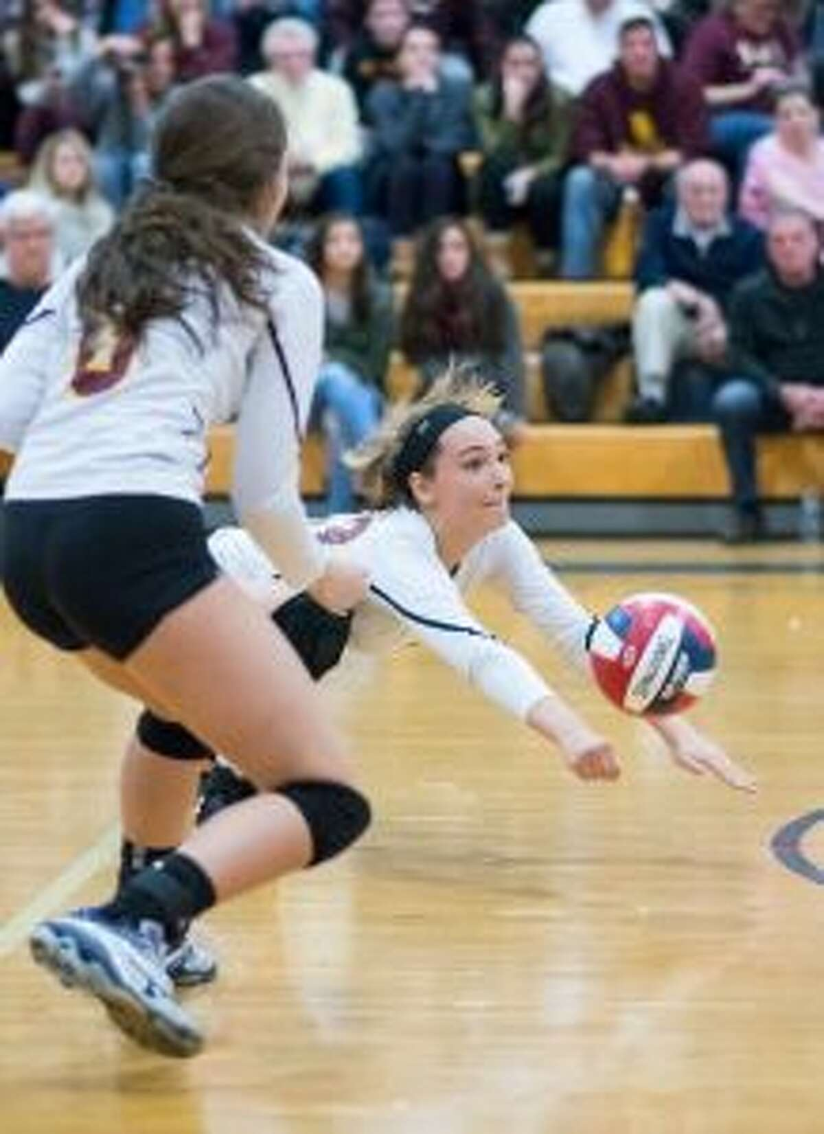 Bridget Fatse gets under the ball to keep the point alive.