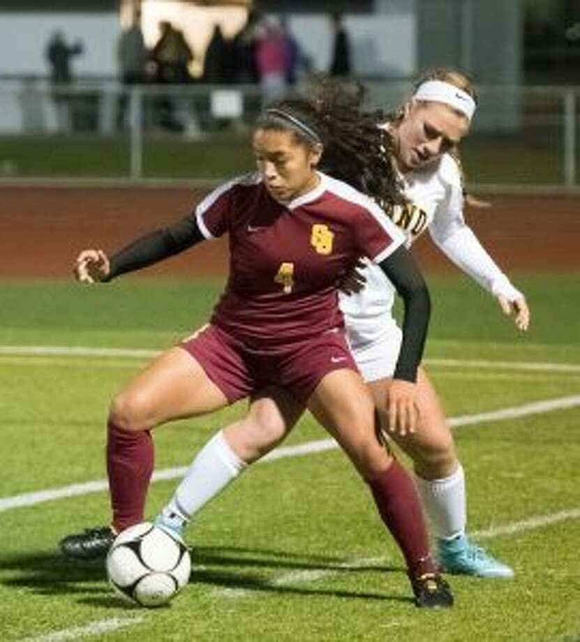 Jessica Mazo (4) looks to keep possession in the corner versus Daniel Hand. — David G. Whitham photos