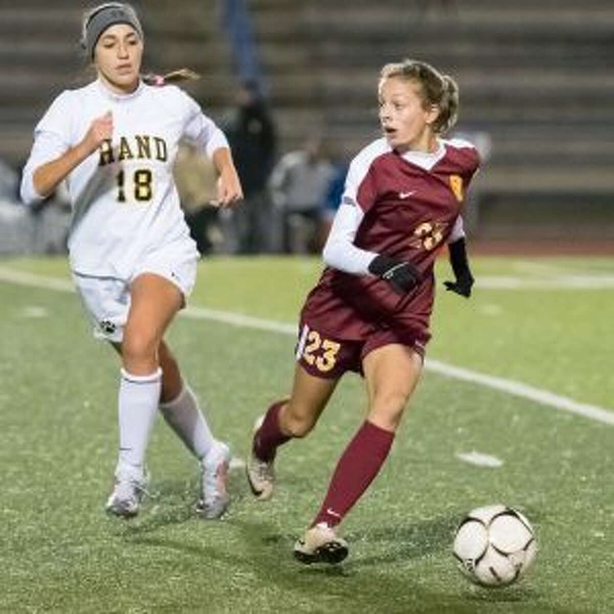 Julia DiCesare (23) looks for an open teammate, as Daniel Hand's Vivianna Mazzarella looks to defend.