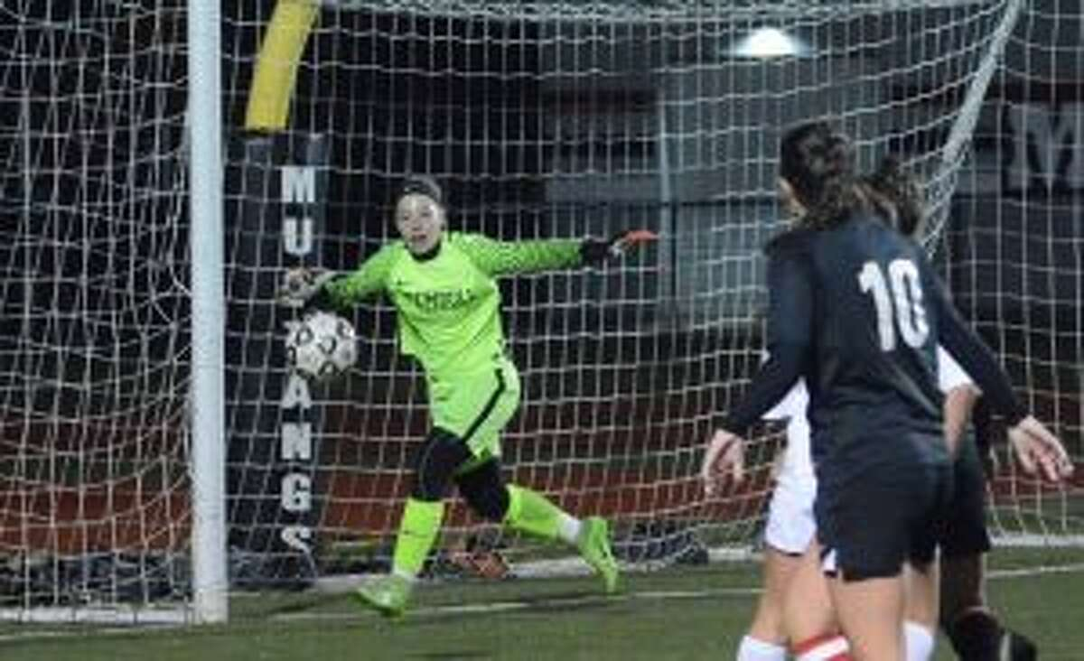 Trumbull's Avery Rice made seven saves, including one on a penalty kick, to lead the Eagles. - Andy Hutchison photos