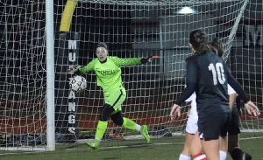Trumbull's Avery Rice made seven saves, including one on a penalty kick, to lead the Eagles. — Andy Hutchison photos