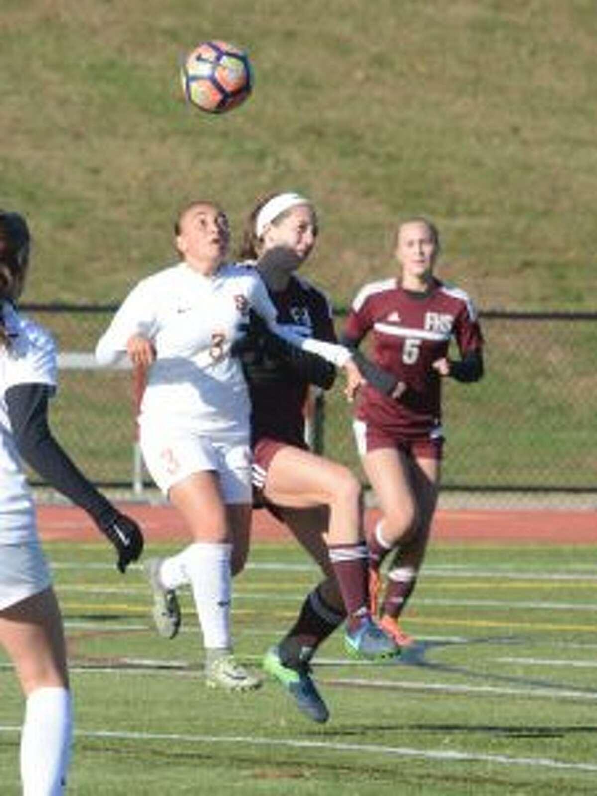 Andriana Cabral wins a ball in the air versus Farmington.