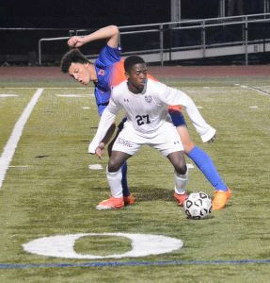 Myles Summers fends off a Danbury striker.