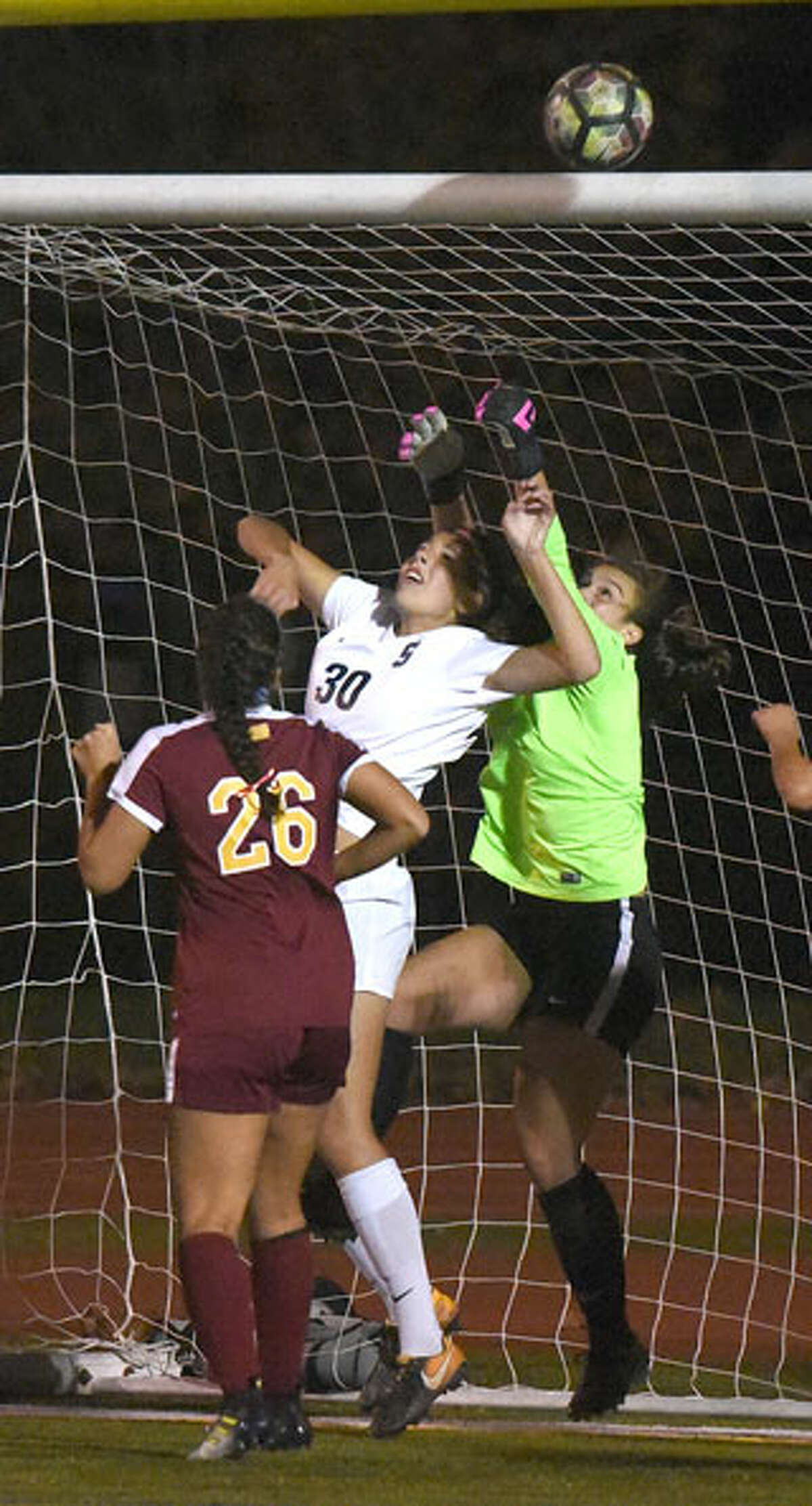St. Joseph goalie Veronica O'Rourke punches a last-second shot by Staples over the crossbar. - Dave Stewart/HAN Network photo