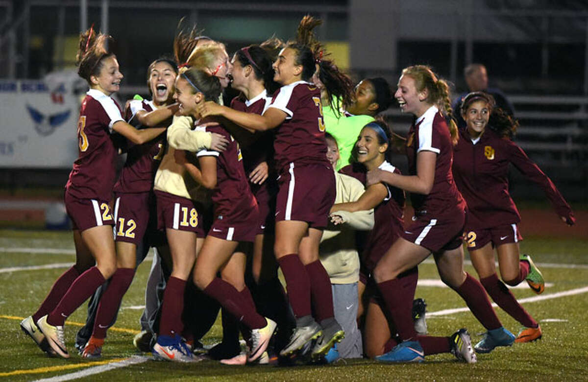The St. Joseph Cadets celebrate after winning the FCIAC girls soccer championship Friday night at Fairfield-Ludlowe HS. - Dave Stewart/HAN Network photo