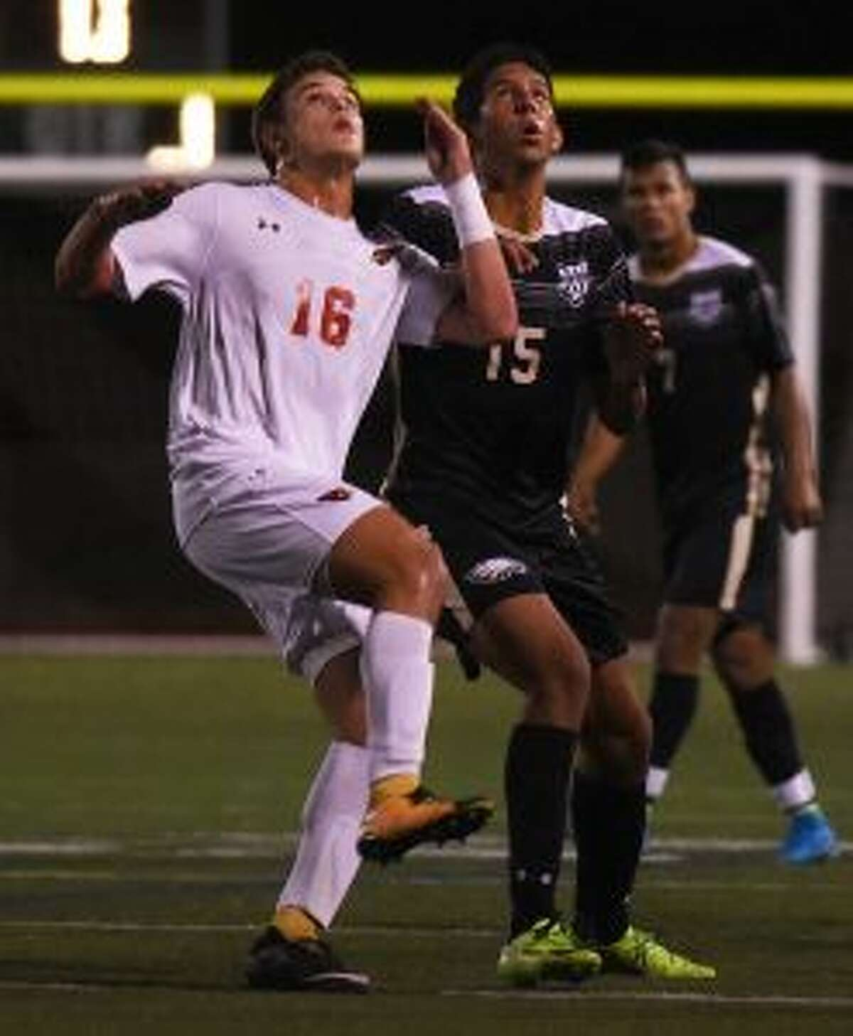 Greenwich's Francisco Ligouri and Trumbull'sMatheus Santiago look to make a play in the air. - Dave Stewart photo