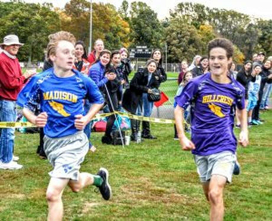 Madison's Will Eckert looks back at Hillcrest's Deal Wesley just before crossing the finish line to take first at the Middle School Cross Country Championships. — Lisa Romanchick photos