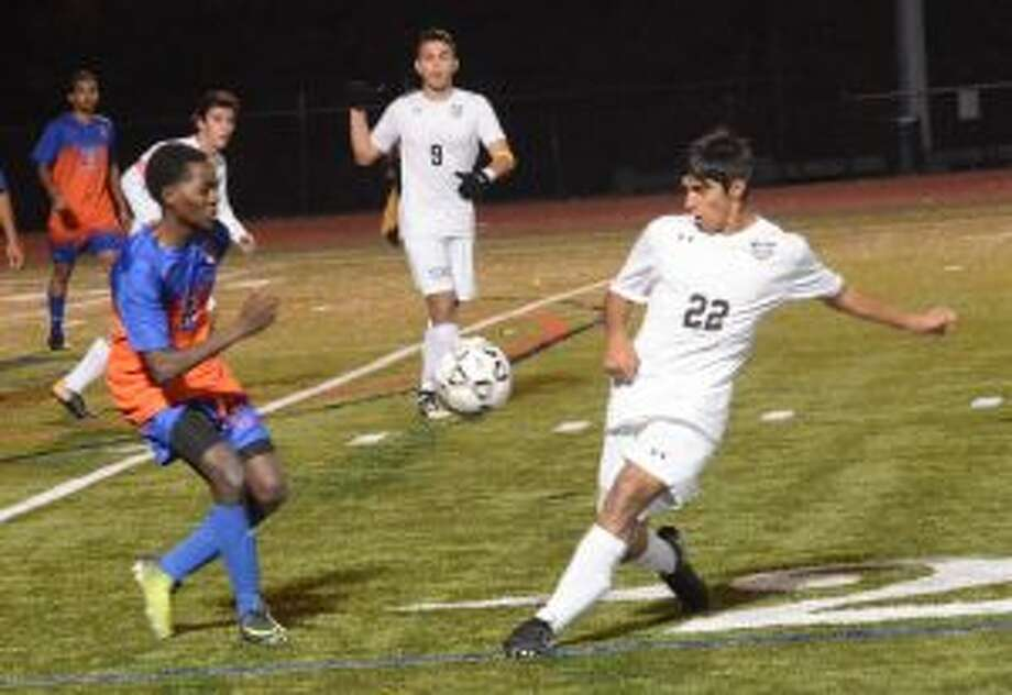 Trumbull's Andrew Restrepo works for possession across from Danbury High's Joe Morocho in the FCIAC semifinals. — Andy Hutchison photos