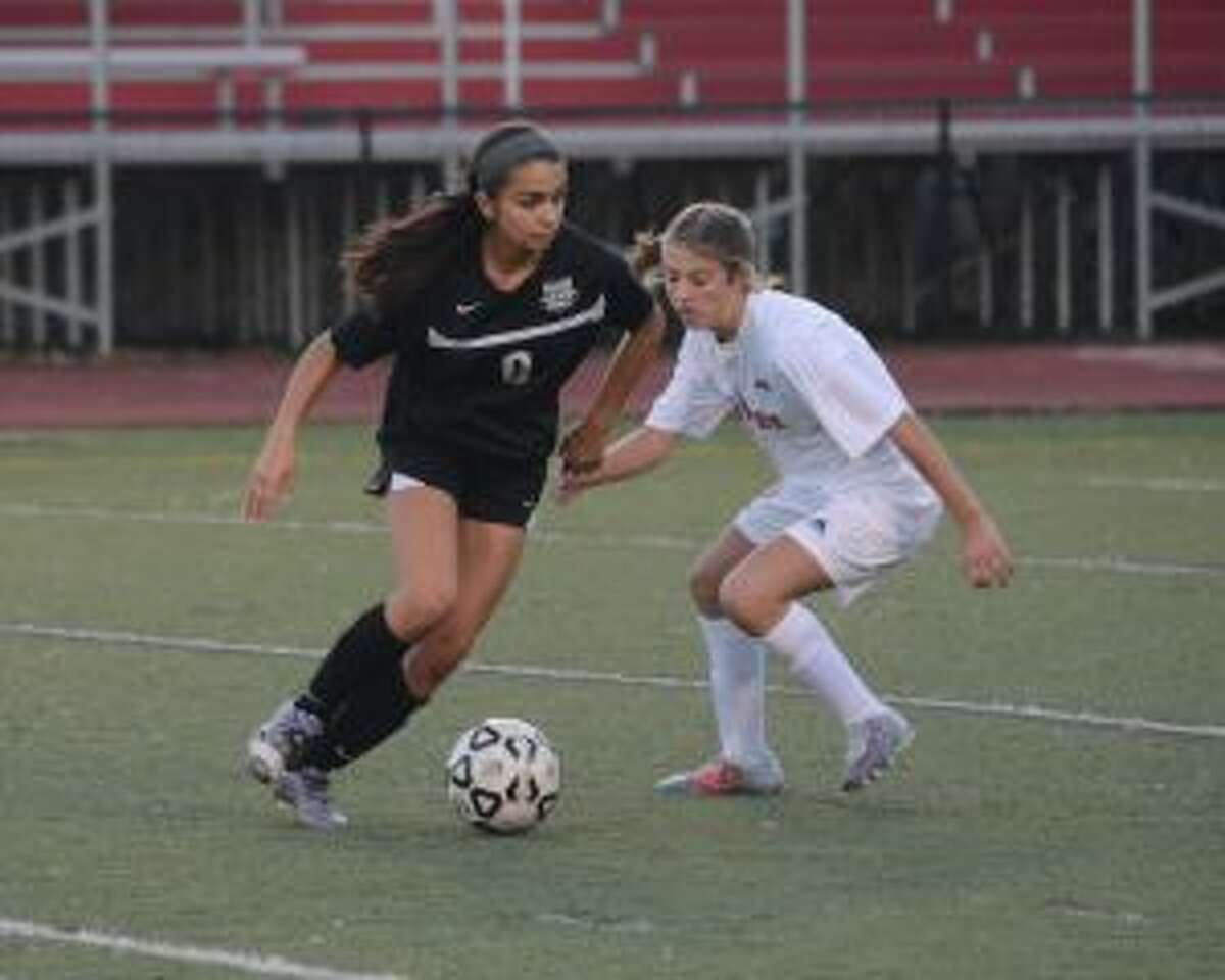 Trumbull's Skylar Jorge looks to get past a Warde defender. - Andy Hutchison photo