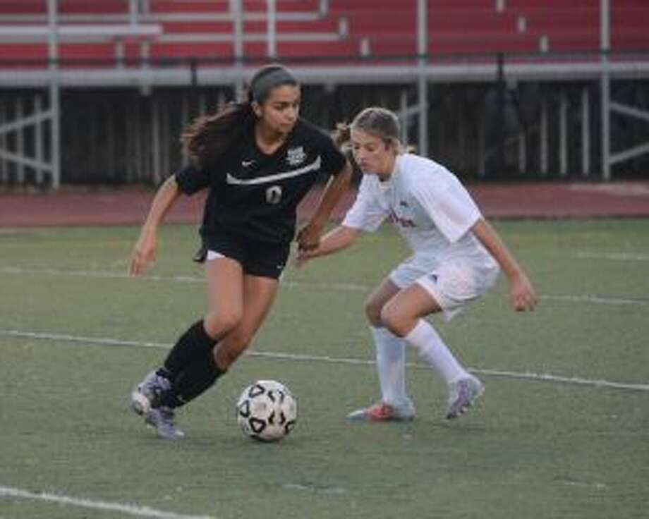 Trumbull's Skylar Jorge looks to get past a Warde defender. — Andy Hutchison photo