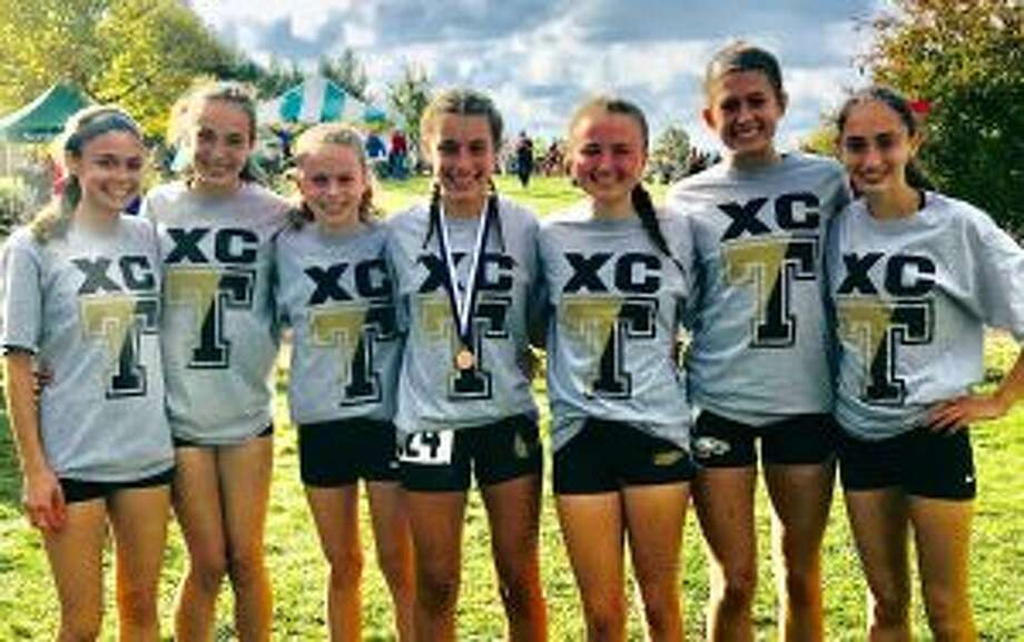 Trumbull's runners Lianne Iassogna, Calyn Carbone, Kiki Grant, Ally Zaffina, Maggie LoSchiavo, Ashley Storino and Brenna Asaro placed fifth in Class LL and qualified for the State Open.