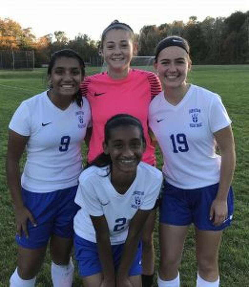 Ranita Muriel, Soph Luft and Bella Christian gather in the back row around Natania Muriel.