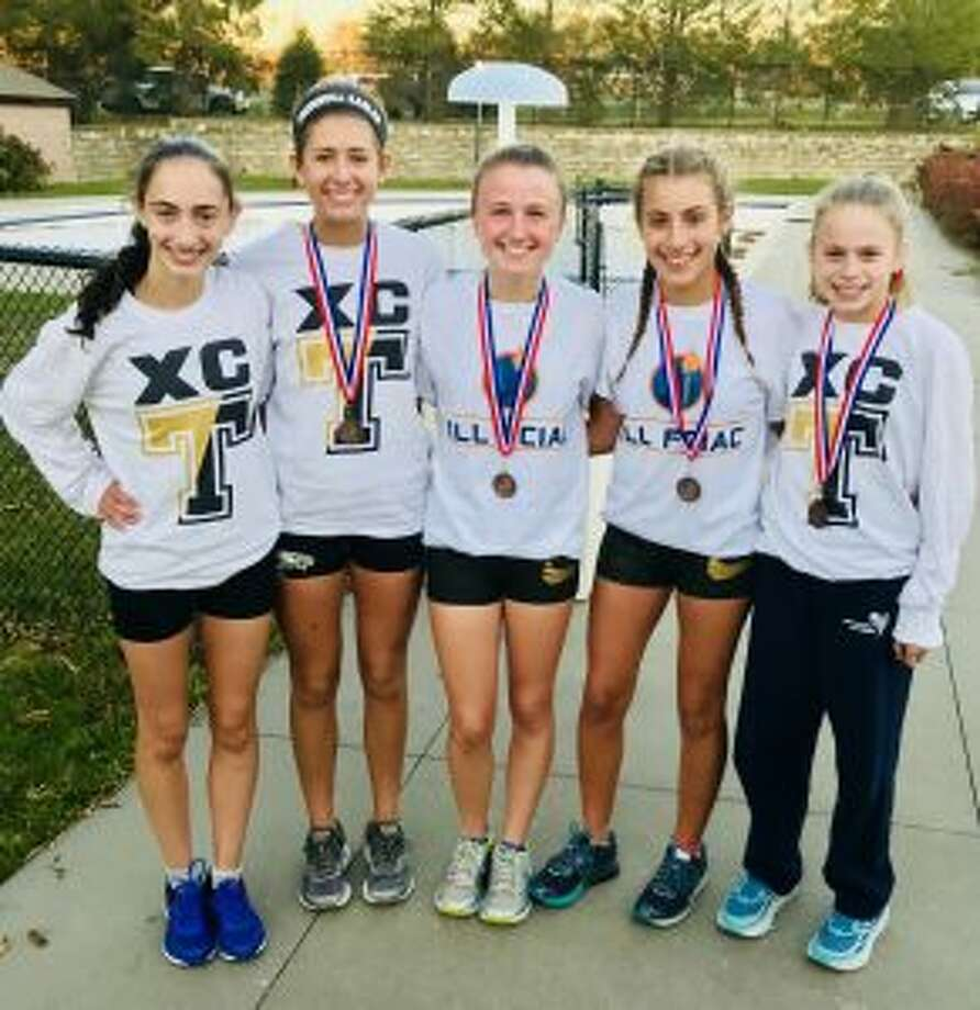 Trumbull's top five varsity runners, Brenna Asaro, Ashley Storino, Maggie LoSchiavo, Ally Zaffina and Kiki Grant, posted the fastest team combined time in school history at the FCIAC Championship Meet on Oct. 18.