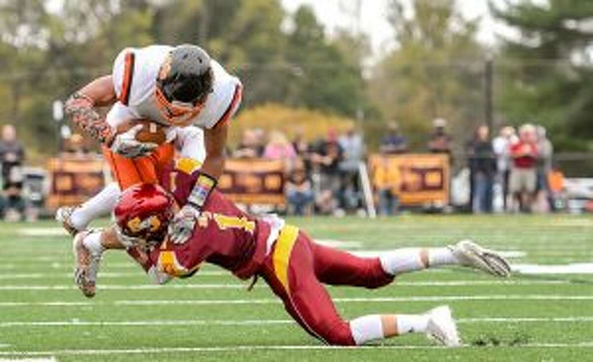 Ridgefield's Jackson Mitchell is upended by St. Joseph's Ace Luzietti.