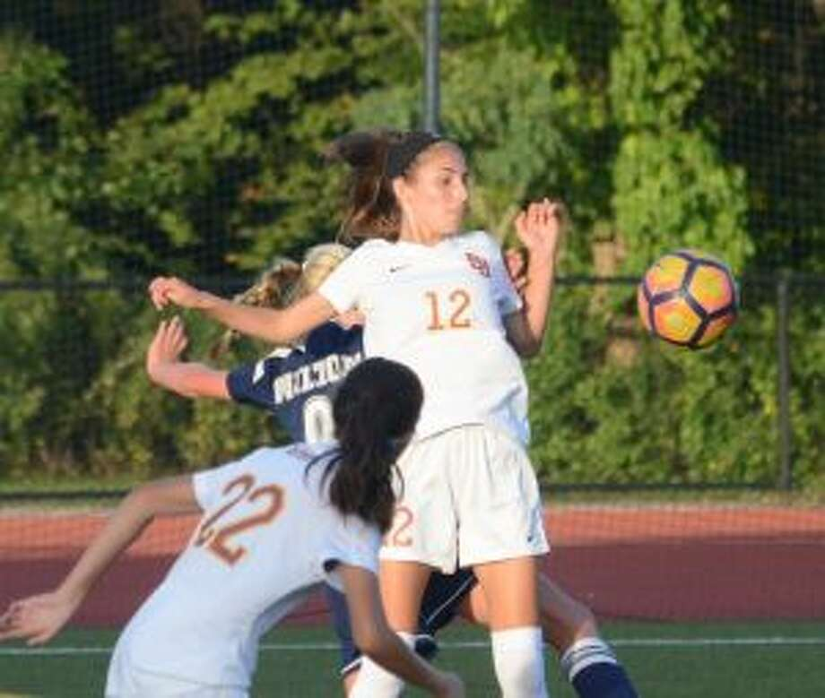 St. Joseph's Ashley Collins plays a header toward a teammate. — Andy Hutchison photo