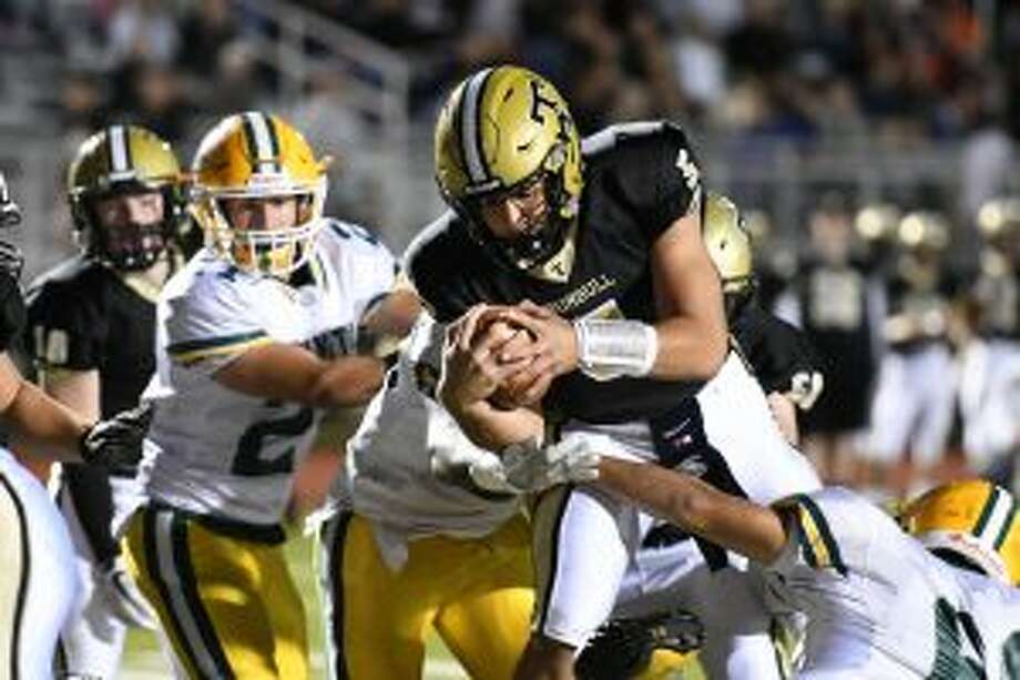 Trumbull's Colton Nicholas fights for the yards needed to score. — David G. Whitham photos