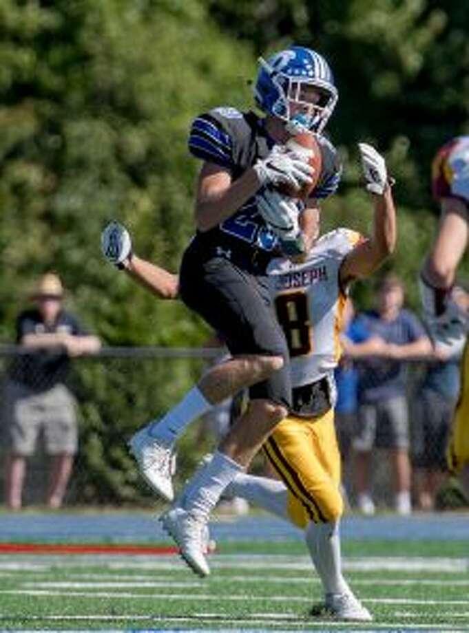 Darien receiver Tyler Herget (29) comes down with a pass, as Darren Warren closes. — David G. Whitham photos